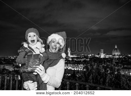 Mother And Child In Florence Showing Christmas Present Box