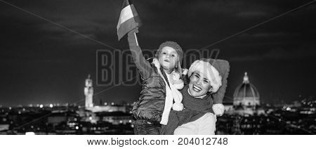 Mother And Daughter In Christmas Hats In Florence Rising Flag