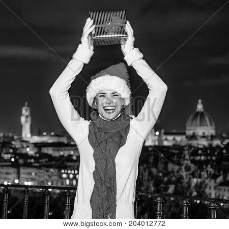Woman With Christmas Present Box In Florence, Italy Rejoicing