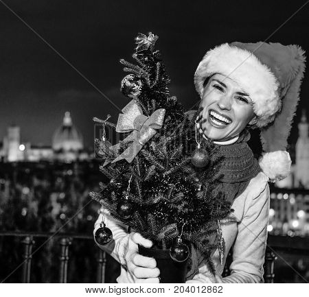 Smiling Young Woman In Florence, Italy With Christmas Tree