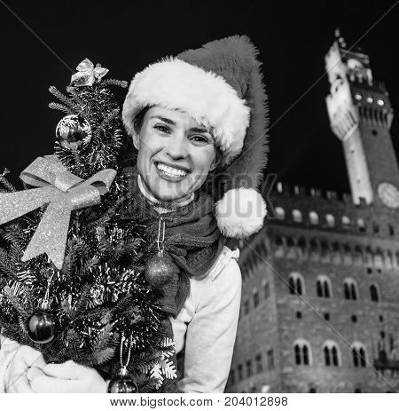 Happy Tourist Woman Against Palazzo Vecchio With Christmas Tree