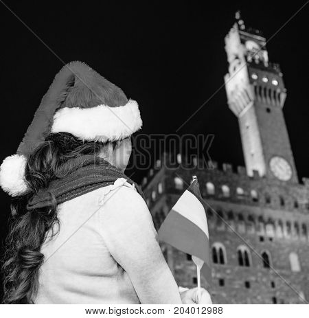 Woman In Christmas Hat Near Palazzo Vecchio With Italian Flag