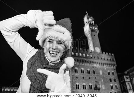 Woman In Christmas Hat In Florence, Italy Framing With Hands