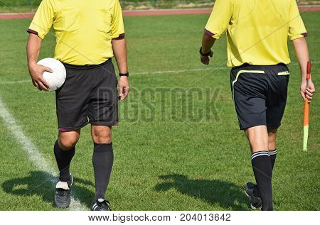 Soccer referees on the field before match