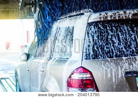 The car is in the tunnel for washing.