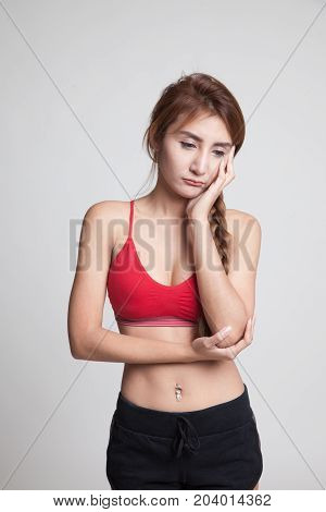 Beautiful Young Asian Woman In Sport Dress Get Bored.
