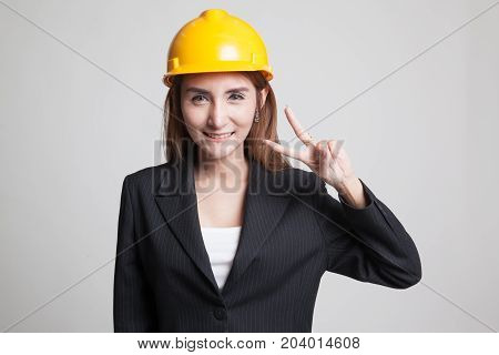 Asian Engineer Woman Show Victory Sign.