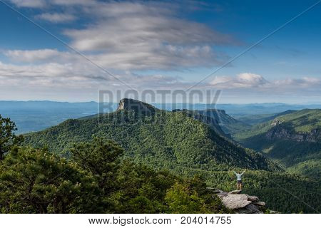 Woman Power Posing with Table Rock Mountain in Background in Linville Gorge