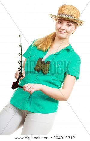 Fishery spinning equipment angling sport and activity concept. Happy smiling woman with fishing rod.