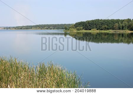 Panoramic view of the broad channel of the river Ros in a quiet day in the early autumn Ukraine.