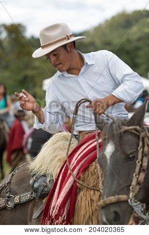 May 27 2017 Sangolqui Ecuador: cowboy in saddle on his horse during a rural rodeo in the Andes