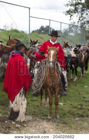 May 27 2017 Sangolqui Ecuador: cowboys from the Andes in traditional wear having a conversation at a rural rodeo