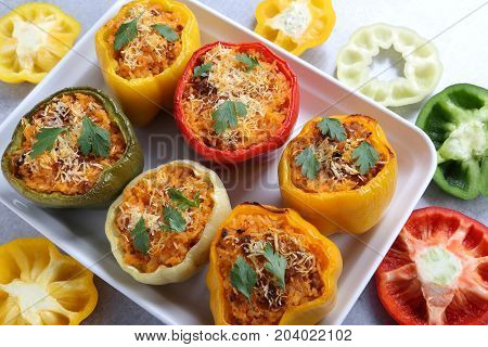 Stuffed paprika with meat cheese rice and vegetables.