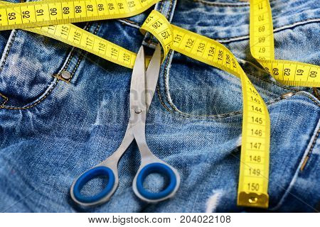 Jeans Belt Loops, Zipper And Pocket With Scissors, Selective Focus.