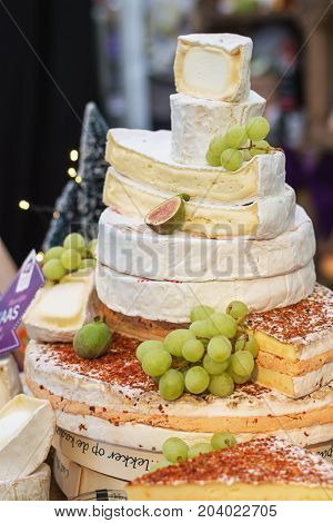 Utrecht Netherlands December 9 2016: Stack delicious French cheeses on the food festival.