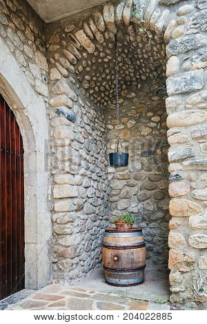 Wine barrel in a cove in the village Vogue which is recognized as historical heritage and is considered one of ten charming villages of France