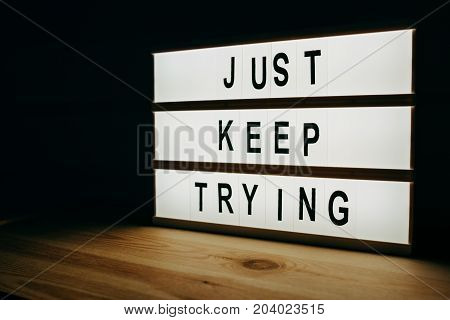 Just keep trying motivational message on lightbox