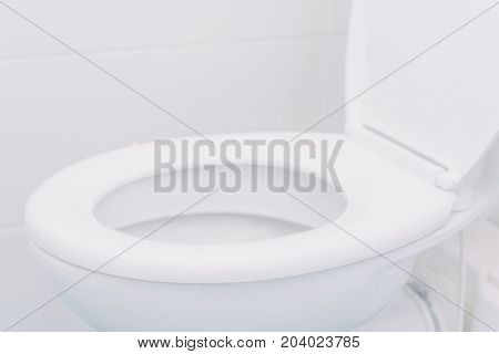 White toilet seat in bathroom selective focus with copy space