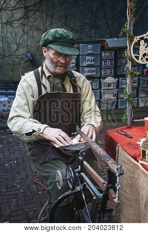 Deventer Netherlands - December 18 2016: Man is busy with the figure saw at the Dickens Festval in Deventer