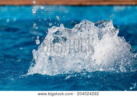 Splashing water in the pool as a background .