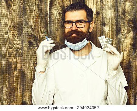 Bearded Brutal Caucasian Doctor Or Postgraduate Student Holding Pills