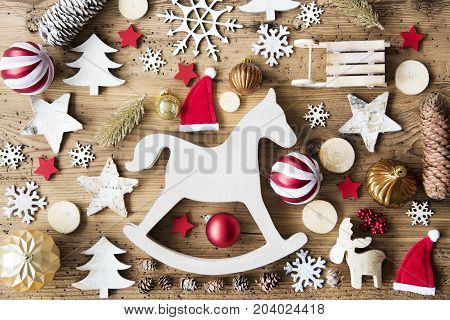 Flat Lay With Many Christmas Decoration, Like Rocking Horse, Ball, Sleigh, Fir Cone And Tree. Vintage Rustic Wooden Background