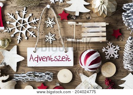 Signboard With German Text Adventszeit Means Advent Season. Christmas Decoration Like Sled, Ball, Christmas Tree And Snowflake. Brown Rustic Woodn Background. Natural Style