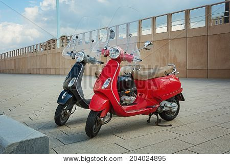 Scheveningen The Netherlands - August 9 2017: Two trendy scooters parked on the boulevard in Scheveningen in Netherlands