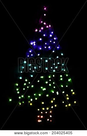 Colorful Bright Glowing Magic Christmas Tree. Silent And Peaceful Atomosphere. Christmas Card For Happy Holidays Or Seasons Greetings