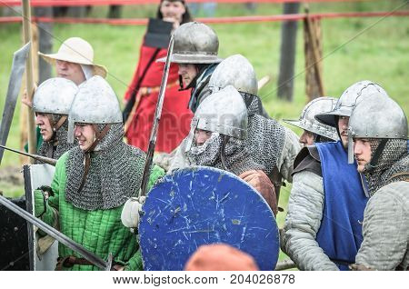 Moscow,russia-june 06,2016: Armored Warriors In Ancient Costumes Fighting On Battlefield