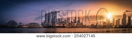 Panorama image of Singapore Skyline and view of skyscrapers on Marina Bay view from the garden by the bay at sunset.