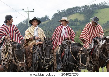 May 27 2017 Sangolqui Ecuador: a group of cowboys riding their horses towards a rural rodeo in the Andes