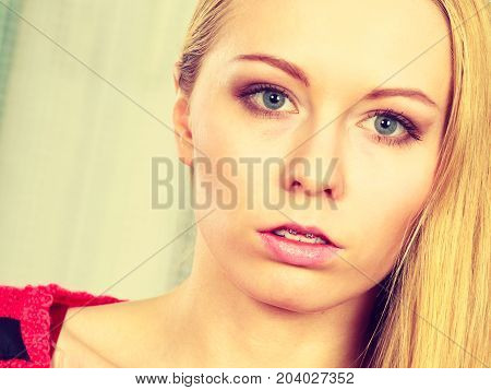 Feminity expressions concept. Portrait of blonde woman with serious neutral face expression