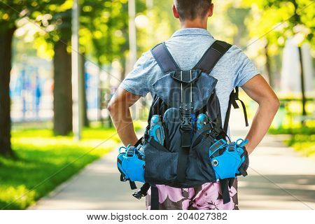 Young Male Roller Skater With Roller Backpack - Shoot From Behind.