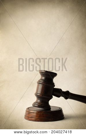 Wooden Gavel On Block With Parchment Style Background