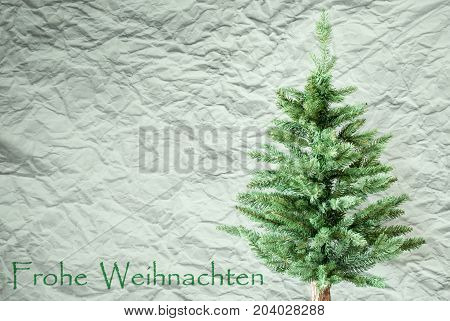 Crumpled Paper Background WIth German Text Frohe Weihnachten Means Merry Christmas. Christmas Tree Or Fir Tree In Front Of Textured Background.