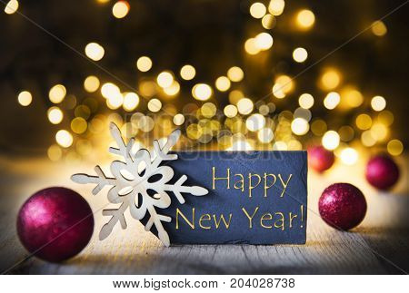 Plate With Golden English Text Happy New Year. Bright Glowing Lights In The Background. Christmas Ornament Like Red Balls And Snowflake.
