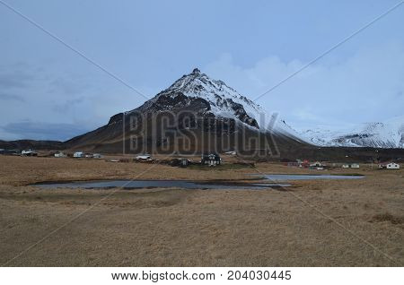 Snow dusting the top of Mount Stapafell in Iceland.