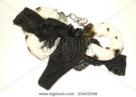 Handcuffs and black thong on white background poster