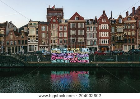 Amsterdam Netherlands - January 5 2017: Light Festival Amsterdam a message of love in lights in an Amsterdam canal.
