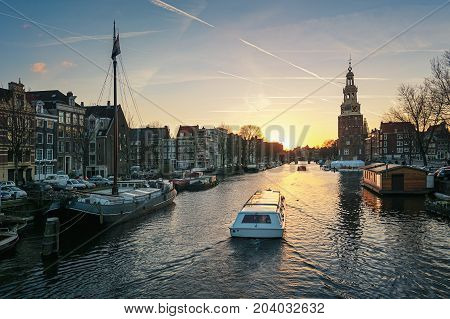 Amsterdam Netherlands - January 5 2017: View on the canal Oudeschans at Sunset in the center of Amsterdam.