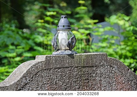 Lantern on the tombstone in the Public cemetery