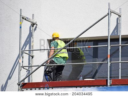 Construction worker at work on a construction frame