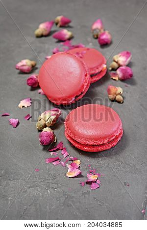 .french Dessert. Sweet Pink Macaroons Or Macarons With Dry Rose
