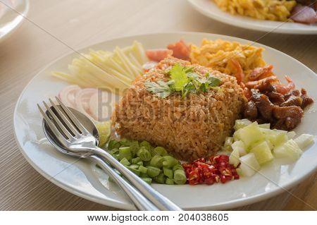 Shrimp Fried Rice is popular Thai food. Beautifully arranged with nuts, chilli, lime, dried shrimp, onions, eggs and more.