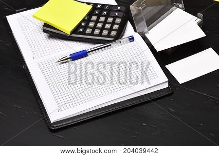 Business And Work Concept: Calculator, Notebook And Business Card Holder