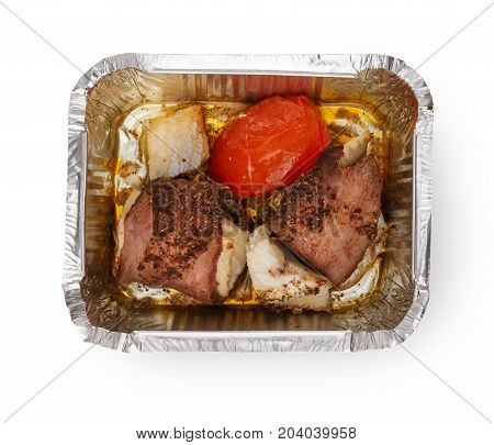 Healthy lunch in foil container. Healthy food take away and delivery. Meat, rice and tomato in box on white background, closeup, isolated