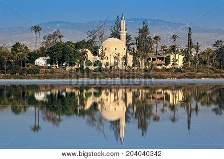 View of the Mosque of Umm Haram or Hala Sultan Tekke on the west bank of Larnaca Salt Lake near Larnaca, Cyprus