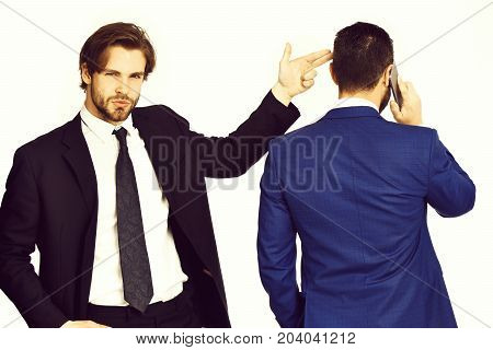 diversion and sabotage harassment corruption man with gun gesture shooting busy businessman speaking on phone in formal suit isolated on white background poster