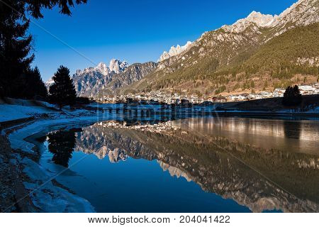 View of Auronzo di Cadore village and Santa Caterina lake in the region of the Dolomites mountain range in northern Italy
